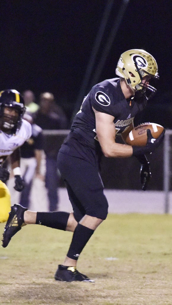 Greer's Matthew Mason (43) takes a Union County fumble in for a touchdown during Greer's 63-20 win Friday night at Dooley Field.