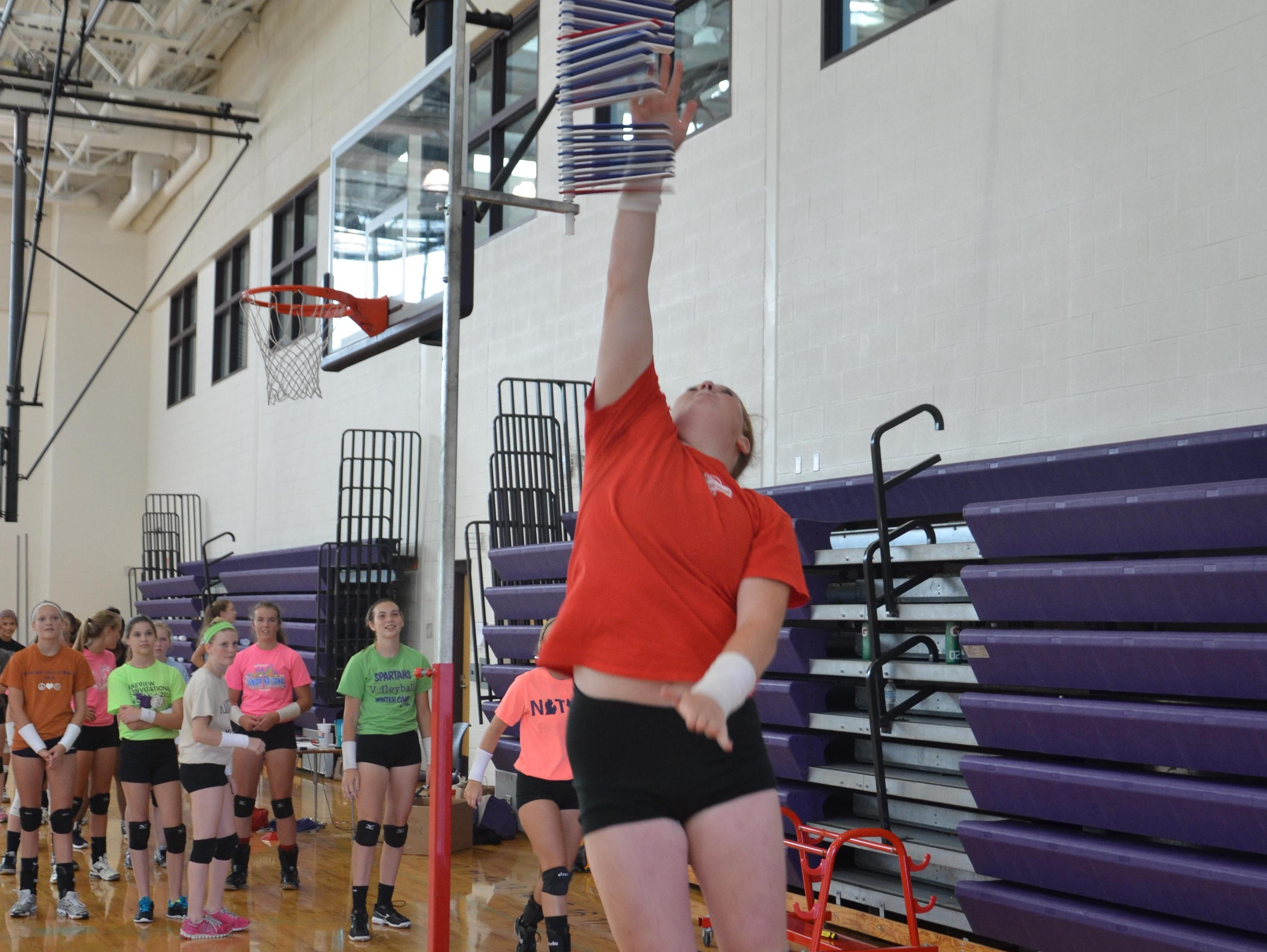 Lakeview's Emily Eldridge goes vertical for a test during the first day of volleyball practice on Wednesday.