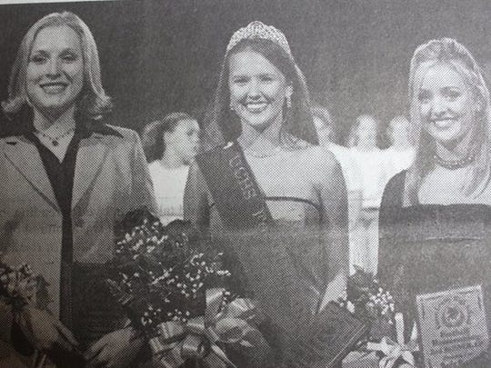 Union County High School senior Meghan Elder, center, was crowned the 2004 Football Homecoming Queen during a Friday night game in October against Hopkinsville. At the left is first runner-up, Katelyn Wadlington, and at the right is second runner-up Jade Ervin.