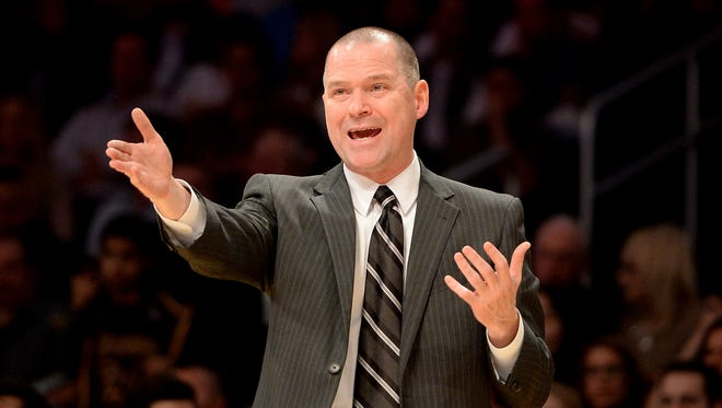 Michael Malone coaches the Kings on Dec. 9.