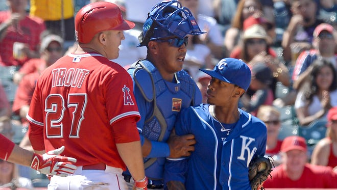 Royals RHP Yordano Ventura and Angels OF Mike Trout exchange words at home plate.