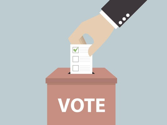 Businessman hand putting voting paper in the ballot box, Voting concept