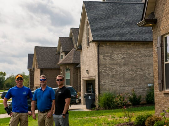 From left, local Clarksville builders Marty Darnell,