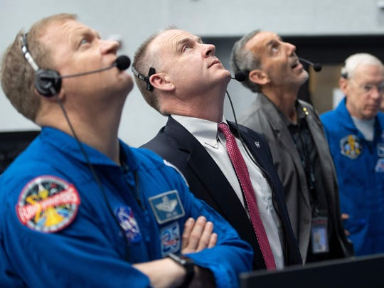 NASA astronaut Doug Hurley, left, and chief of the