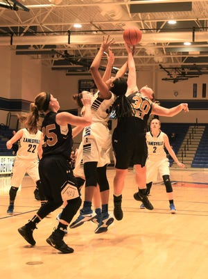Zanesville's Tasia Staunton and River View's Cydney Whiteus fight for a rebound in the Lady Bears' 39-35 win on Saturday.