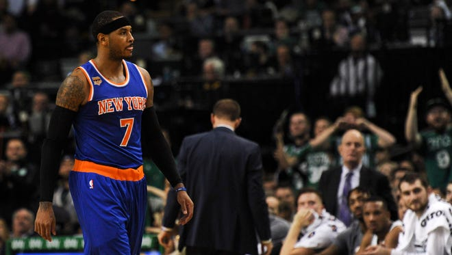 New York Knicks forward Carmelo Anthony (7) walks off the court after receiving his second technical foul during the first half against the Boston Celtics at TD Garden.