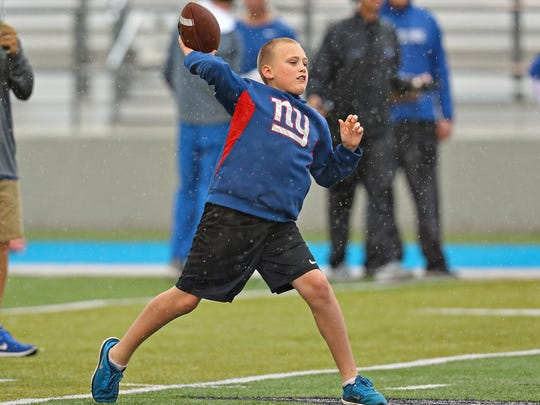 Tatum Marks, the son of former MTSU quarterback Clint Marks, celebrates his 10th birthday by throwing a pass during MTSU's spring finale at Floyd Stadium on April 14, 2018.