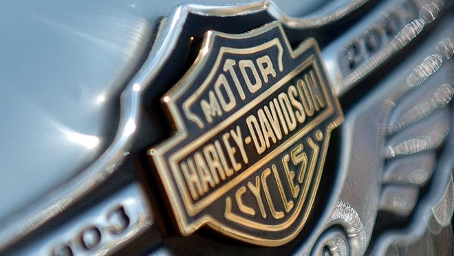 A Harley-Davidson 100th Anniversary badge.