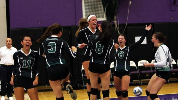 Yorktown players celebrate after winning the first game 27-25 at John Jay in a girls volleyball showdown Tuesday. Yorktown went on to win in a rematch of last year's Class A final, which also went to the Huskers.