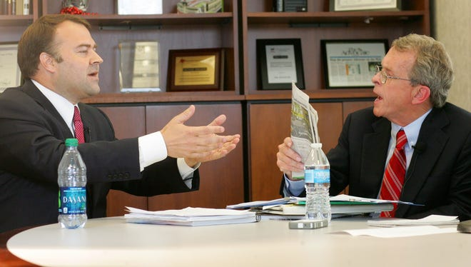 Ohio Attorney General Mike DeWine, a Republican, and Democratic challenger David Pepper, left, argue over a third-party advertisement that is critical of the incumbent.