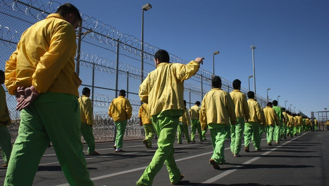Immigrant detainees walk through the Immigration and Customs Enforcement (ICE), detention facility on Feb. 28, 2013 in Florence, Ariz.