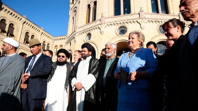 Norwegian Prime Minister Erna Solberg, in blue, and Muslim leaders at an anti-ISIS demonstration in Oslo on Monday.