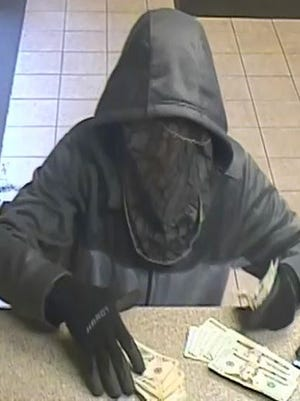 Battle Creek police detectives and the FBI are searching for a man who robbed a Fifth Third Bank on Saturday, the second robbery at the location in less than a month.