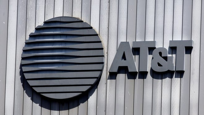 The AT&T logo and initials sit atop their building in this file photo in Arlington, Va.