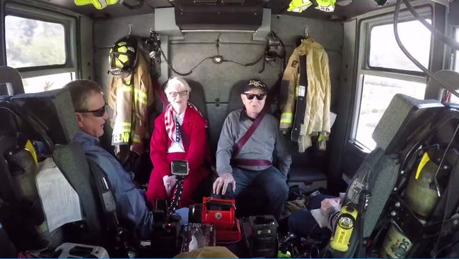 Longtime Mesa police and firefighter supporters Betty Lee, 90, and former mayor Wayne Pomeroy, 94, enjoy a ride along in Mesa Fire Engine 201 on Feb. 16, 2017.