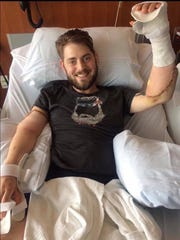 John Peck following the double arm transplant he received