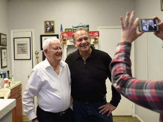 Salvatore Castellano, left, the owner of Sal's Haircutters for Men in Englewood, poses for a photo with longtime customer Michael Haledjian on Saturday, his last day of business.