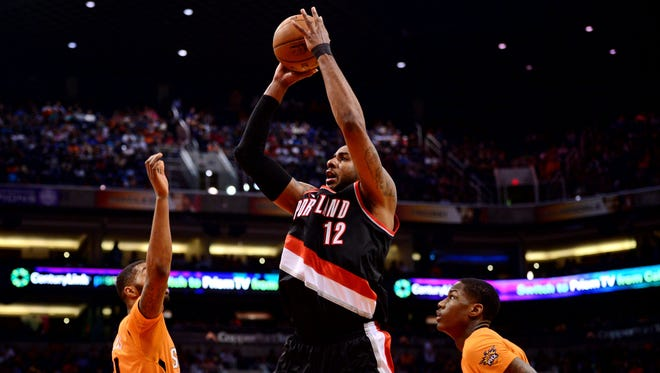 Portland Trail Blazers forward LaMarcus Aldridge (12) shoots over Phoenix Suns forward Markieff Morris (11) and guard Archie Goodwin (20) during the second half at US Airways Center on March 17, 2015. Can the Suns land Aldridge in free agency?