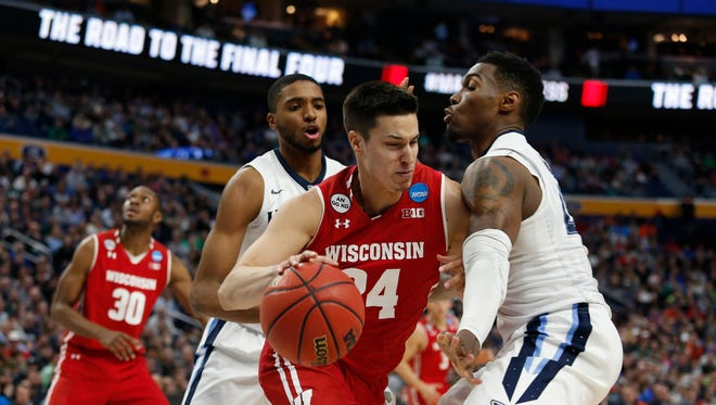 Mar 18, 2017; Buffalo, NY, USA; Wisconsin Badgers guard Bronson Koenig (24) tries to drive against Villanova Wildcats forward Darryl Reynolds (45) in the second half during the second round of the 2017 NCAA Tournament at KeyBank Center.