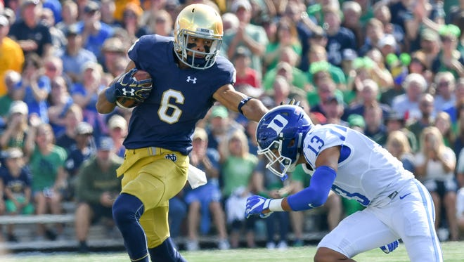 Notre Dame Fighting Irish wide receiver Equanimeous St. Brown (6) runs after the catch as Duke Blue Devils safety Jordan Hayes (13) attempts to tackle in the first quarter at Notre Dame Stadium.