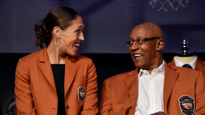 Inductees into the Basketball Hall of Fame, Rebecca Lobo and George McGinnis, smile as they sit together during a news conference at the Naismith Memorial Basketball Hall of Fame.