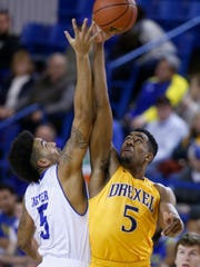 Delaware's Eric Carter (left) vies for the opening tip with Drexel's Austin Williams at the Carpenter Center.