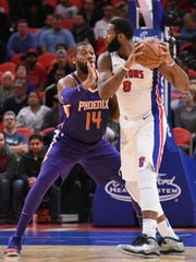 Pistons center Andre Drummond (0) is defended by Suns center Greg Monroe (14) during the first quarter on Wednesday, Nov. 29, 2017, at Little Caesars Arena.