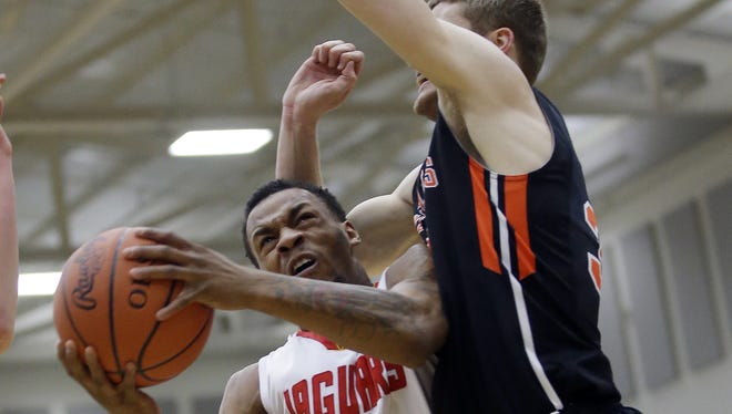 Shroder's Tony Brown (3) drives to the basket during their regional semi-final against Versailles, Thursday, March, 19,2015.