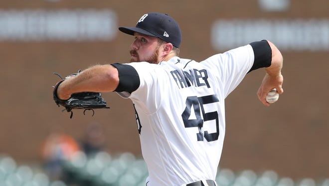Detroit Tigers relief pitcher Buck Farmer throws during the 10th inning in the win over the Tampa Bay Rays on Wednesday.