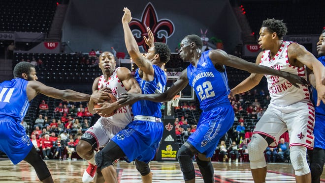 Johnathan Stove, driving to the basket here vs. New Orleans in December, and Bryce Washington (right), have spent a lot of time around each other during their four seasons together at UL.