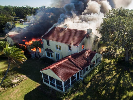 A photo taken from a drone shows the 1205 Twin Palm Drive home engulfed in flames on Sunday.