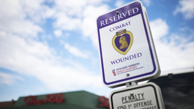 The ShopRite at Lincoln and Landis avenues features a new designated parking space for Wounded Warriors, a project prompted by the Buena Vista Veterans Committee.