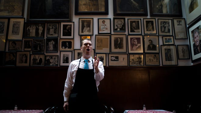 Server and opera singer Stephen Dagrosa, 28, of Haddon Heights sings inside Victor Cafe in Philadelphia. The legendary restaurant offers traditional Italian menu paired with professional opera performances.