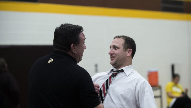 Deptford head coach Ralph Ross Jr., left, and St. Joseph head coach Mark Manchio shake hands before a match Saturday, Jan. 9 in Delran.
