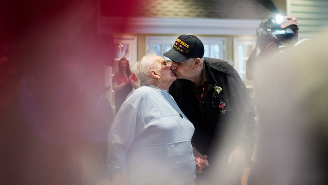 After 67 years of marriage, Mildred Seltzer, 88, kisses her husband Arthur Seltzer, 92, as they renew their vows with help from mayor Chuck Cahn Friday, Feb. 12 at Spring Hills Assisted Living in Cherry Hill.
