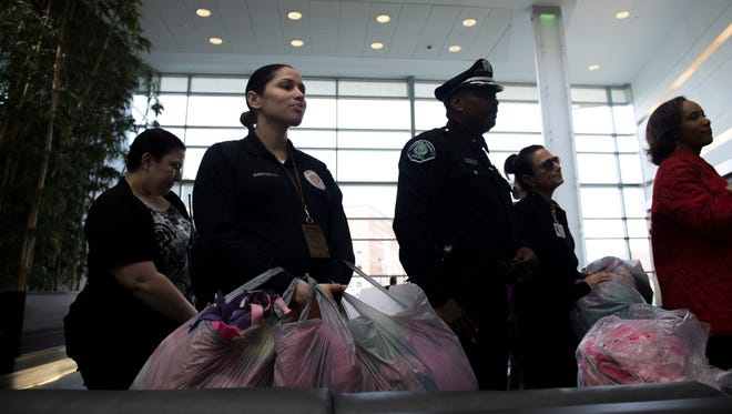 Sgt. Janell Simpson holds bags of blankets inside Cooper University Hospital as part of Operation Guardian Wednesday, March 23 in Camden.