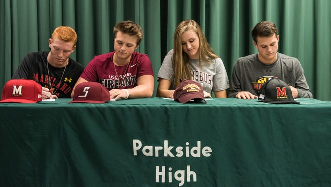 From left, Sean Fisher, Connor Shockley, Lindsay Mooney, and Grant Burleson sign contracts for their respective colleges at Parkside High School on Wednesday, Nov. 9, 2016.