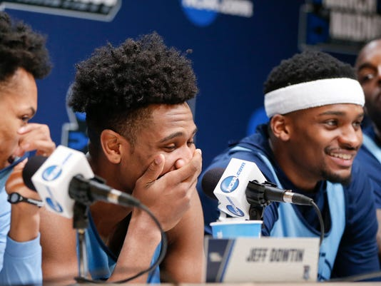 Rhode Island's Jeff Dowtin, left, E.C. Matthews, center left, and Stanford Robinson, center right, all share a laugh as Jared Terrell, right, looks on during an NCAA men's college basketball tournament news conference, Friday, March 16, 2018, in Pittsburgh. Rhode Island faces Duke in a second-round game on Saturday. (AP Photo/Keith Srakocic)
