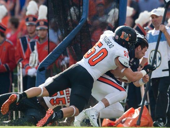 Mercer linebacker Logan Craighead (50) hits Auburn
