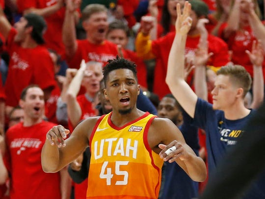 Utah Jazz guard Donovan Mitchell (45) celebrates after scoring a three-point basket against the Oklahoma City Thunder in the first half during Game 3 of an NBA basketball first-round playoff series Saturday, April 21, 2018, in Salt Lake City.