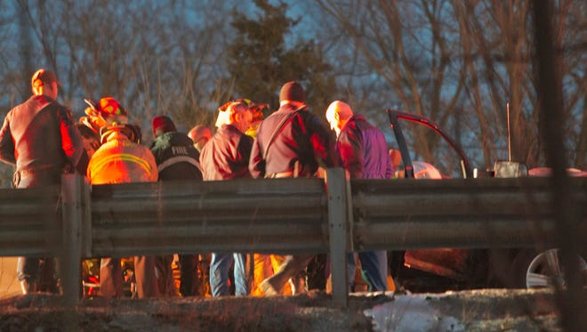 Green Oak Firefighter, Livingston County EMS paramedics and Survival Flight personnel tend to a patient in a multi-vehicle accident on southbound U.S. 23 south of M-36 Monday evening involving a semi tanker truck that rolled over.
