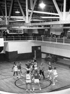 Two of the amateur independent basketball teams fight it out at the Dearborn gym in 1972.
