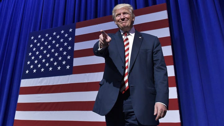 Donald Trump arrives on stage for a rally in Aston,