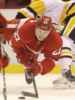 Detroit Red Wings' Joe Hicketts goes for the puck against the Pittsburgh Penguins during first period action Tuesday, September 27, 2016 at Joe Louis Arena in Detroit.