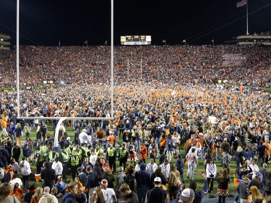 Auburn fans react at the end of a win over Alabama