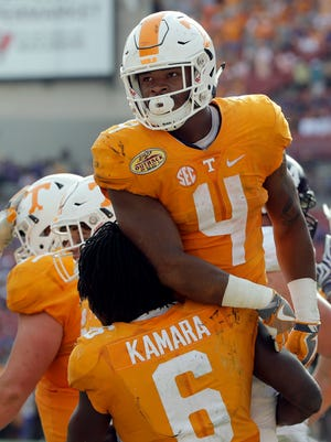 Tennessee running back John Kelly (4) celebrates with teammate running back Alvin Kamara (6) after scoring against Northwestern in the fourth quarter in the Outback Bowl on Jan. 1, 2016.