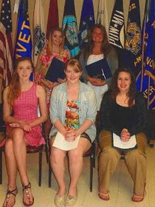 Scholarship winners: From left, seated, are the AADAA winners in grades 9-12, Caroline Johnson, Sophia Swoboda and Ashlynn Corrigan; standing are students who received scholarships from the Ladies Auxiliary and Sons of AmVets, Haley Britcher and Emily Albright.