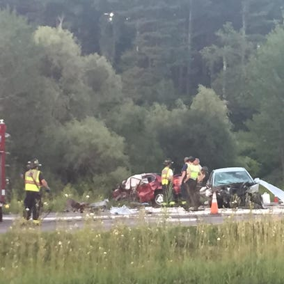 Emergency crews respond to the scene of a head-on crash