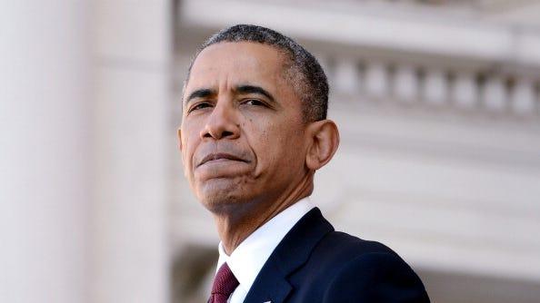 U.S. President Barack Obama speaks during a ceremony on Veterans Day at Arlington National Cemetery on Nov. 11, 2013 in Arlington, Virginia.