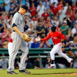 Seattle Mariners starting pitcher Mike Montgomery tosses a new ball in the air as Boston Red Sox's Rusney Castillo, right, rounds the bases after his two-run home run during the first inning of a baseball game at Fenway Park in Boston Friday, Aug. 14, 2015.